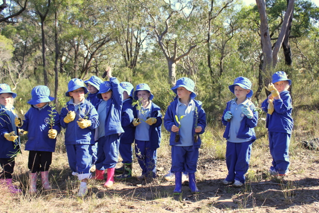 9 children ready and waiting to plant trees