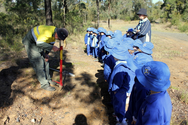 8 kids learning how to plant trees