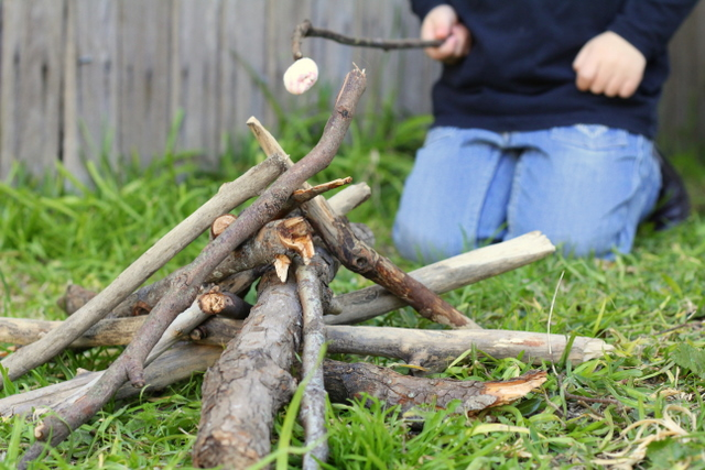 Stick play camp fire