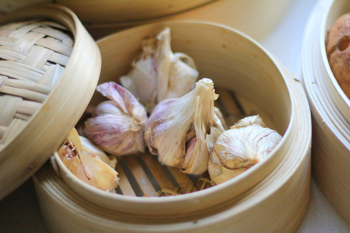 A bamboo steamer is a great place to store garlic