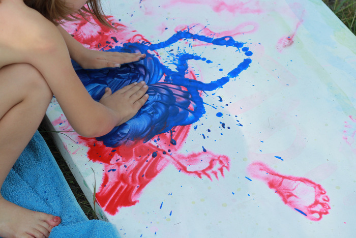 Kids body painting on canvas using washable paints 2