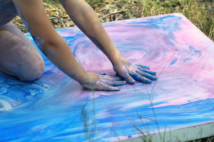 Kids body painting on canvas using washable paints 4