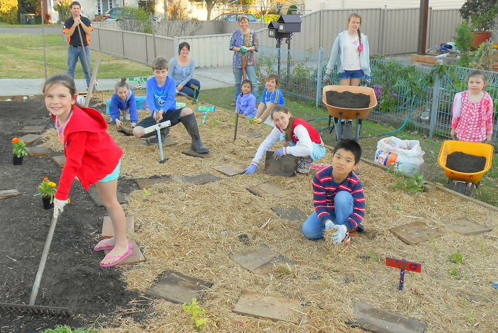 Neighbourhood kids creating a community verge veggie garden. Graeme Stuart.