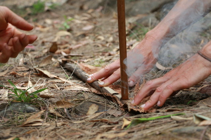 Wildcraft Australia bush survival courses Hunter Valley Australia. Hand drill fire starting - smoke. Little eco footprints.