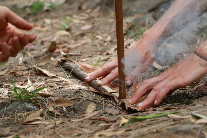 Wildcraft Australia bush survival courses Hunter Valley Australia. Hand drill fire starting - smoke. Little eco footprints.