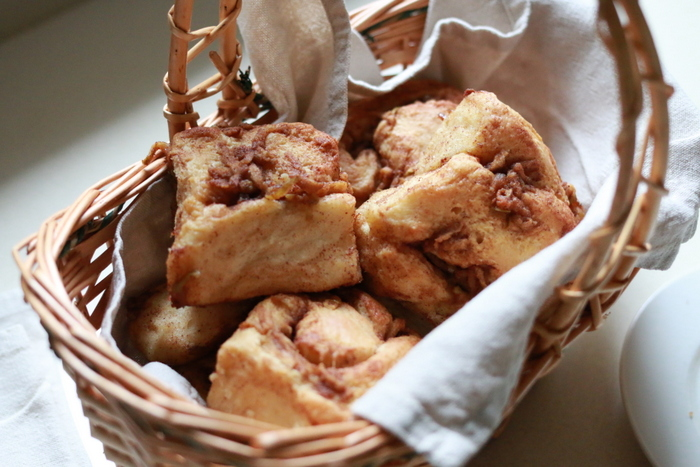 The gift economy builds community. A basket of gifted sourdough cinnamon scrolls. Little eco footprints